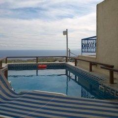 Отель Anemomilos Suites Греция, Остров Санторини - отзывы, цены и фото номеров - забронировать отель Anemomilos Suites онлайн бассейн фото 2