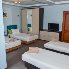 Апартаменты White Rose Apartments комната для гостей