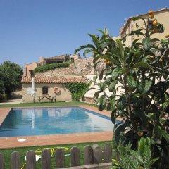 Отель Masía Puigadoll бассейн