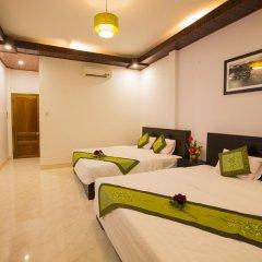 Отель The Village Homestay 2* Стандартный семейный номер с двуспальной кроватью фото 4