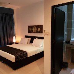 Отель East Suites Улучшенный номер с различными типами кроватей