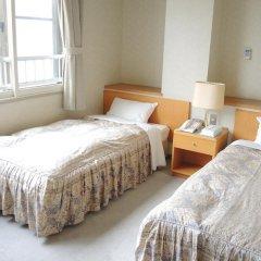 Отель Mine-no-yu Япония, Уторо - отзывы, цены и фото номеров - забронировать отель Mine-no-yu онлайн комната для гостей фото 5