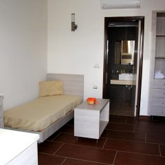 Апартаменты Maria Apartments Парадиси комната для гостей фото 4