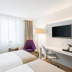 Отель NH Collection Berlin Mitte Am Checkpoint Charlie 4* Улучшенный номер с разными типами кроватей фото 14