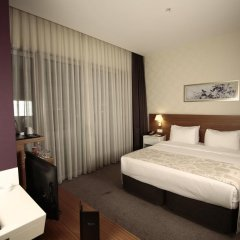 Отель Ramada Plaza Istanbul Asia Airport комната для гостей фото 2