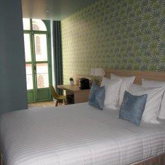 Отель Hôtel Du Centre 2* Улучшенный номер с различными типами кроватей фото 6