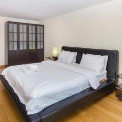 Апартаменты Emerald Palace - Serviced Apartment Паттайя комната для гостей фото 3