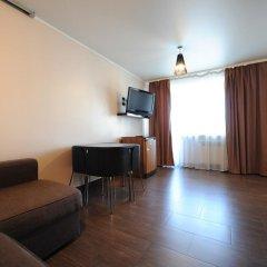 Апартаменты на Республики 86 Тюмень комната для гостей фото 5