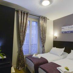 Отель Hôtel du Quai de Seine 2* Стандартный номер с различными типами кроватей фото 2