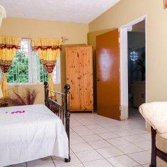 Отель Ackee Tree Sea View Villa Ямайка, Порт Антонио - отзывы, цены и фото номеров - забронировать отель Ackee Tree Sea View Villa онлайн комната для гостей фото 5