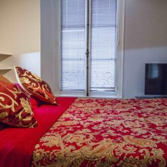 Апартаменты Notre Dame Apartments Париж комната для гостей фото 2