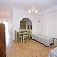Отель Panorama Apartments Греция, Порос - 1 отзыв об отеле, цены и фото номеров - забронировать отель Panorama Apartments онлайн комната для гостей фото 2