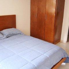 Отель Suites del Carmen - Wisconsin Мехико комната для гостей фото 2