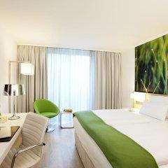 Отель NH Collection Berlin Mitte Am Checkpoint Charlie 4* Стандартный номер с разными типами кроватей фото 36