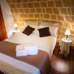 Отель Grandi Trulli Bed & Breakfast Альберобелло комната для гостей фото 2