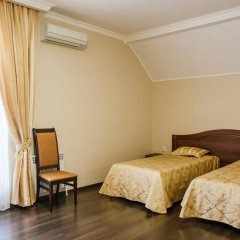 Гостиница Верона Стандартный семейный номер с разными типами кроватей фото 8