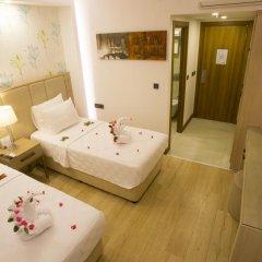 Отель Liberty Hotels Oludeniz 4* Улучшенный номер с двуспальной кроватью фото 10