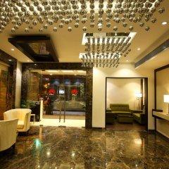 Отель The Prime Balaji Deluxe @ New Delhi Railway Station интерьер отеля фото 3
