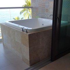 Отель Playa Conchas Chinas 3* Номер Делюкс фото 9