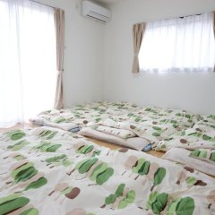 Отель Cottage Kutsuroki Япония, Якусима - отзывы, цены и фото номеров - забронировать отель Cottage Kutsuroki онлайн комната для гостей фото 2