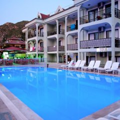 Апартаменты Can Apartments бассейн