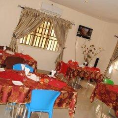 Отель Mikagn Hotel And Suites Нигерия, Ибадан - отзывы, цены и фото номеров - забронировать отель Mikagn Hotel And Suites онлайн питание