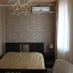 Гостиница Сафари Улучшенный семейный номер с разными типами кроватей фото 3