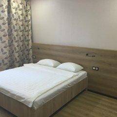 Гостиница Postoyaliy Dvor Inn в Уссурийске отзывы, цены и фото номеров - забронировать гостиницу Postoyaliy Dvor Inn онлайн Уссурийск комната для гостей фото 5