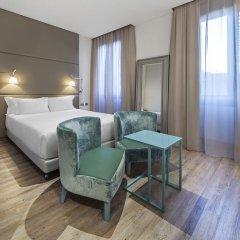 Отель NH Milano Touring 4* Улучшенный номер разные типы кроватей фото 12