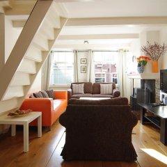 Апартаменты Authentic Jordaan Apartment комната для гостей фото 3