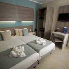 115 The Strand Hotel & Suites Гзира комната для гостей фото 6