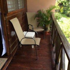 Отель Firefly Beach Cottages балкон