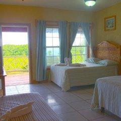 Отель Sea Eye Hotel - Laguna Building Гондурас, Остров Утила - отзывы, цены и фото номеров - забронировать отель Sea Eye Hotel - Laguna Building онлайн комната для гостей
