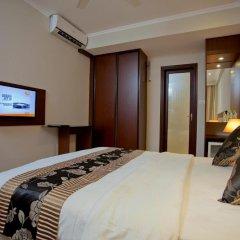 Kaani Beach Hotel 4* Номер Делюкс с различными типами кроватей фото 6