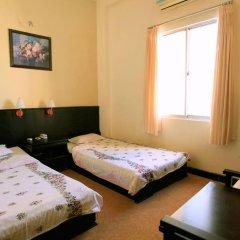 Cuong Long Hotel 2* Стандартный номер с различными типами кроватей фото 4