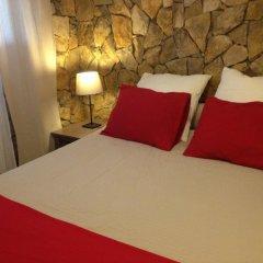 Отель Quatro Sóis Guesthouse комната для гостей