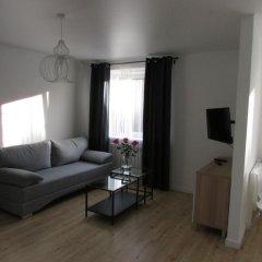 Апартаменты Уют комната для гостей фото 4