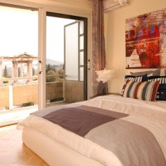 Отель Acropolis Luxury Suite комната для гостей