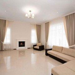 Апартаменты Studiominsk 10 Apartments Минск комната для гостей фото 2
