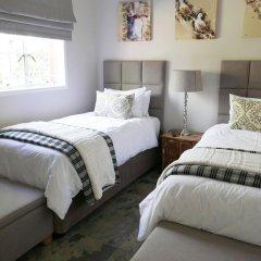 Отель Waterside Cottages Габороне комната для гостей фото 4