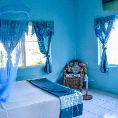 Отель Ackee Tree Sea View Villa Ямайка, Порт Антонио - отзывы, цены и фото номеров - забронировать отель Ackee Tree Sea View Villa онлайн питание