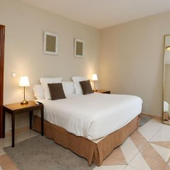 Отель Escala Suites комната для гостей фото 4