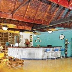 Отель Cocoplum Beach Колумбия, Сан-Луис - 1 отзыв об отеле, цены и фото номеров - забронировать отель Cocoplum Beach онлайн интерьер отеля