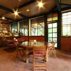 Отель Flower Garden Япония, Минамиогуни - отзывы, цены и фото номеров - забронировать отель Flower Garden онлайн гостиничный бар