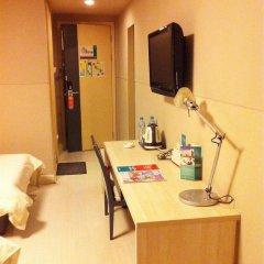 Отель Jinjiang Inn (Huangpu Avenue Bridge) 2* Стандартный номер с 2 отдельными кроватями фото 7