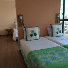 Отель Tahiti Airport Motel 2* Стандартный семейный номер с различными типами кроватей фото 3