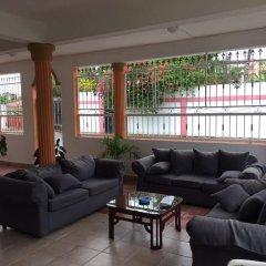 Отель Aparta Hotel Bruno Доминикана, Бока Чика - отзывы, цены и фото номеров - забронировать отель Aparta Hotel Bruno онлайн интерьер отеля