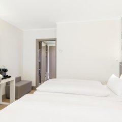 Отель NH Collection Berlin Mitte Am Checkpoint Charlie 4* Улучшенный номер с разными типами кроватей