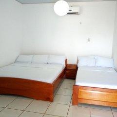 Отель Brenu Beach Lodge Стандартный семейный номер с двуспальной кроватью фото 5