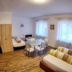 Апартаменты City Apartments Portico Меран комната для гостей фото 3